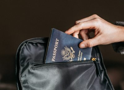 placing passport in bag